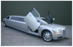 Chauffeur stretch silver Chrysler C300 Baby Bentley limousine hire with Lamborghini doors in Nottingham, Derby, Leicester, Birmingham, Nottinghamshire, Derbyshire, Midlands