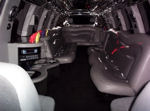 Chauffeur stretched Lincoln Navigator limousine hire interior in UK